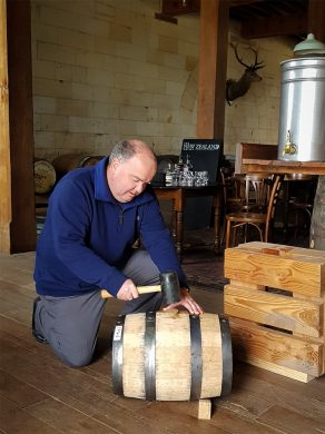 Greg Carson hammering New Zealand Whisky Cask bung